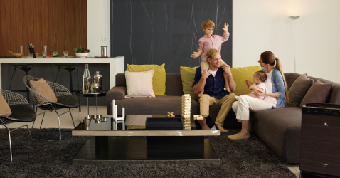 A family hanging out in living room