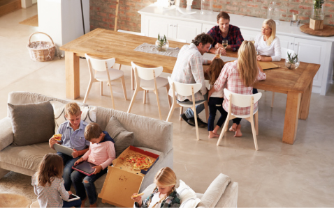 Group of adult in dining area and kids in living area