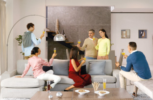 Group of people raising glass in living room